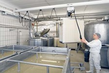 Demag KBK Enclosed Track Crane for Cheese Processing Facility