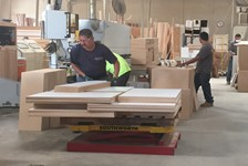 Scissors Lift Tables Solve an Ergonomic Problem for an Office Manufacturing Company