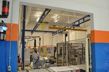 Telescoping Bridge on Free Standing Work Station Crane Helps Streamline Roll Handling Operation