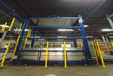 Electro-Mechanical Freightlift Transports Pallets to Conveyor Line