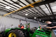 Ceiling Mounted Workstation Bridge Crane Provides Tractor Dealership Maintenance Shop with Lifting Versatility and Efficiency